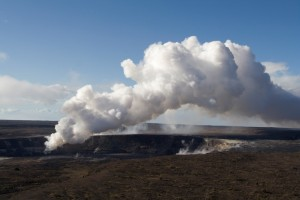"Photo courtesy of Andrew J. Sutton showing volcanic gases boil out of the lava lake within Kilauea's  summit ""Overlook Vent,"" to form the visible vog plume being carried to the southwest and up the Kona             coast by trade winds in this 2008 USGS-HVO photograph."